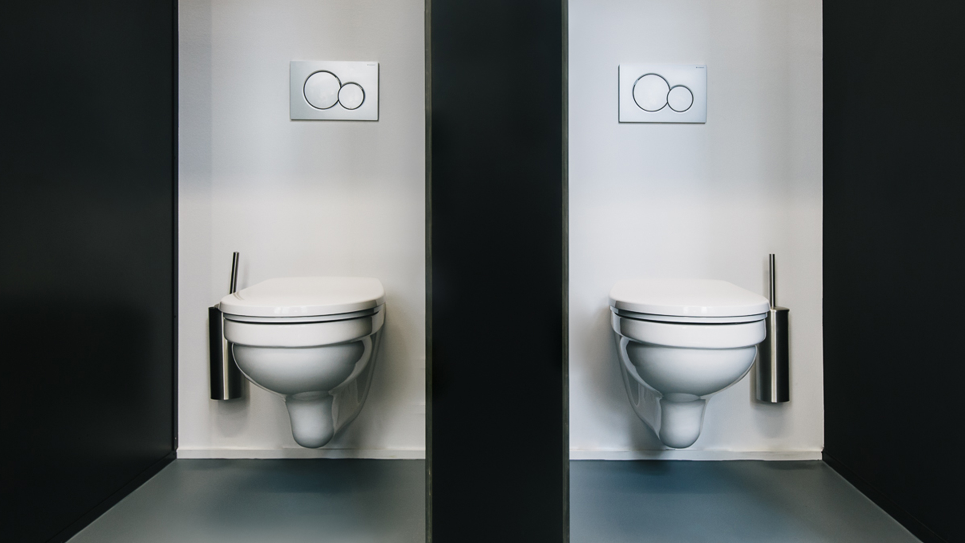 Two toilets separated by a partition